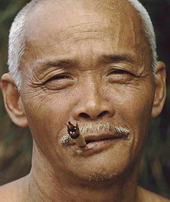 Malaysia. Sabah. Bajau fisherman. Smokes a cigarette he himself rolled.